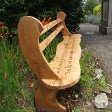 This original Wavy Oak Bench is made to our own unique design. If is comfortable to sit on, has simple elegant lines and shows pure class. - The legs are made extra long so that they can be bedded into the ground to the height that you require.Length 7ft (223cm)- Price includes delivery. Engraved words or phrases can also be carved onto the bench to commemorate that special person or occasion. If you would like wording carved on your bench, pleas....