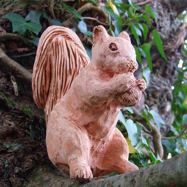 Sitting squirrel wooden garden sculpture